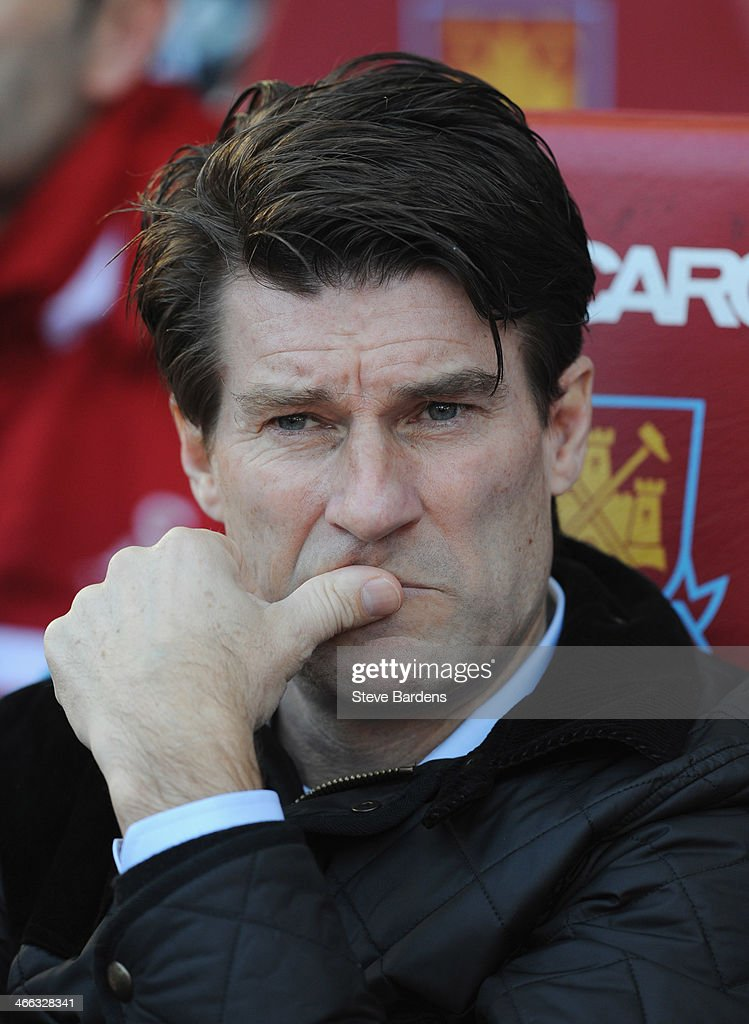 <a gi-track='captionPersonalityLinkClicked' href=/galleries/search?phrase=Michael+Laudrup&family=editorial&specificpeople=2380115 ng-click='$event.stopPropagation()'>Michael Laudrup</a> manager of Swansea City looks thoughtful prior to the Barclays Premier League match between West Ham United and Swansea City at Boleyn Ground on February 1, 2014 in London, England.