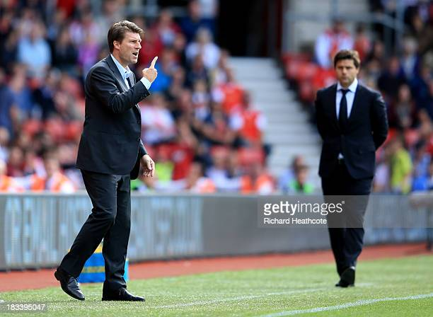 Michael Laudrup manager of Swansea City signals as Mauricio Pochettino manager of Southampton looks on during the Barclays Premier League match...