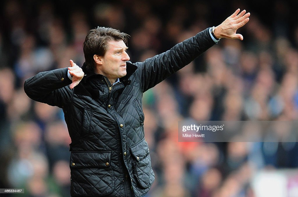<a gi-track='captionPersonalityLinkClicked' href=/galleries/search?phrase=Michael+Laudrup&family=editorial&specificpeople=2380115 ng-click='$event.stopPropagation()'>Michael Laudrup</a> manager of Swansea City signals during the Barclays Premier League match between West Ham United and Swansea City at Boleyn Ground on February 1, 2014 in London, England.