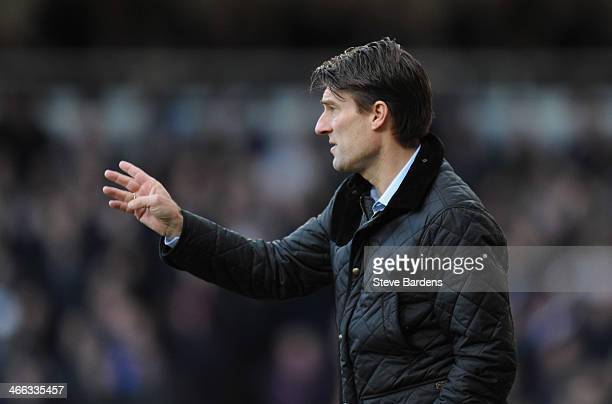 Michael Laudrup manager of Swansea City signals during the Barclays Premier League match between West Ham United and Swansea City at Boleyn Ground on...