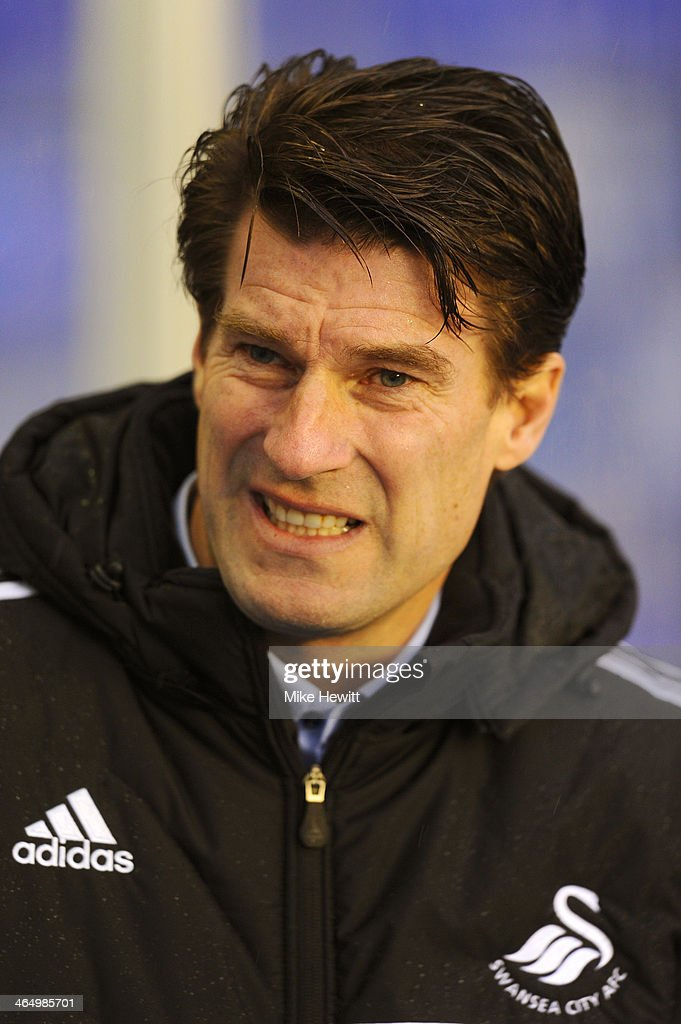 <a gi-track='captionPersonalityLinkClicked' href=/galleries/search?phrase=Michael+Laudrup&family=editorial&specificpeople=2380115 ng-click='$event.stopPropagation()'>Michael Laudrup</a> the Swansea manager looks on prior to kickoff during the FA Cup fourth round match between Birmingham City and Swansea City at St Andrews Stadium on January 25, 2014 in Birmingham, England.