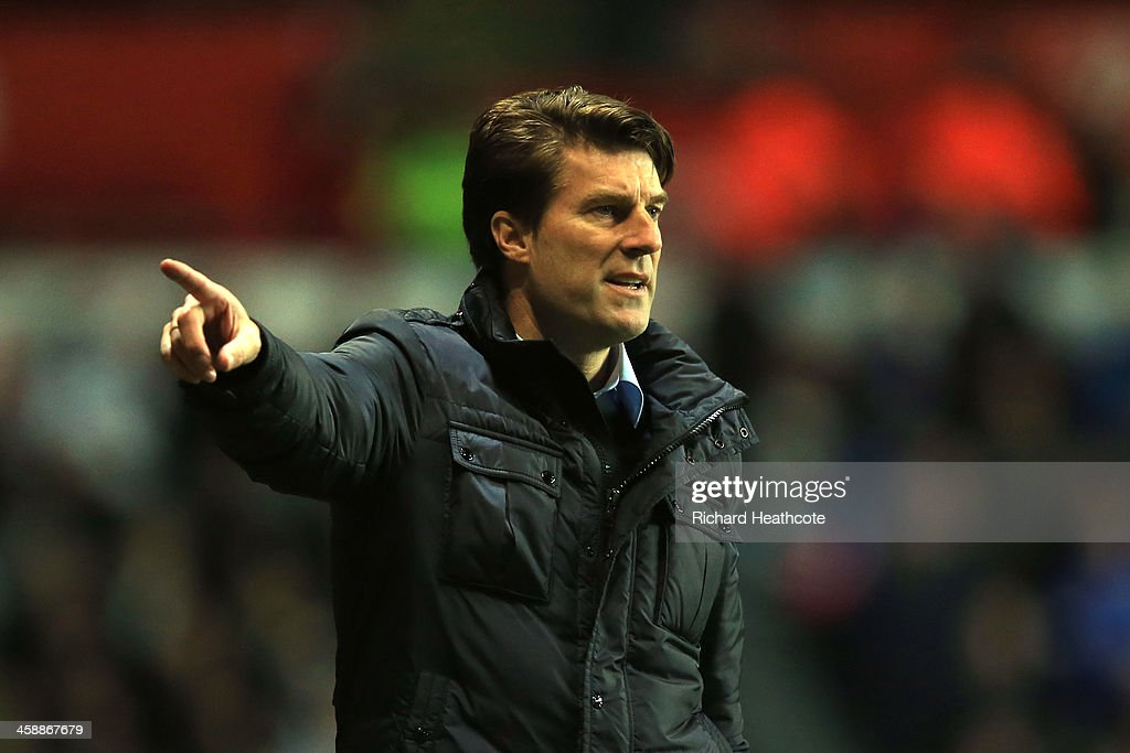 <a gi-track='captionPersonalityLinkClicked' href=/galleries/search?phrase=Michael+Laudrup&family=editorial&specificpeople=2380115 ng-click='$event.stopPropagation()'>Michael Laudrup</a> the Swansea manager reacts during the Barclays Premier League match between Swansea City and Everton at the Liberty Stadium on December 22, 2013 in Swansea, Wales.