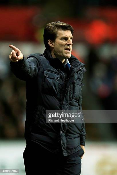 Michael Laudrup the Swansea manager reacts during the Barclays Premier League match between Swansea City and Everton at the Liberty Stadium on...
