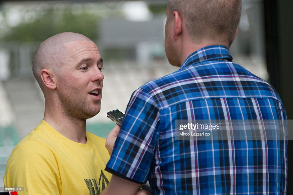 Michael Laverty of Great Britain and Paul Bird Motorsport speaks with a journalist during the MotoGP Tests in Sepang - Day Four at Sepang Circuit on February 6, 2013 in Kuala Lumpur, Malaysia.
