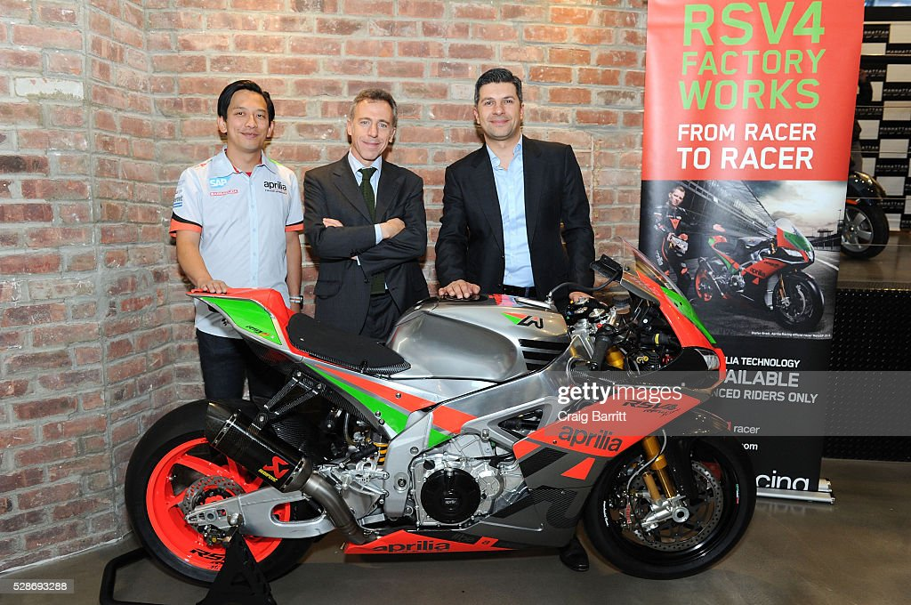Michael Lee, Mario Di Maria, CEO Piagio Group America and Andrew Hadjiminas, President Vespa Manhattan attends the New York debut of the Aprilia RSV4 World SBK RF Misano & Moto Guzzi MGX-21 Flying Fortress at Vespa Manhattan Flagship on May 6, 2016 in New York City.