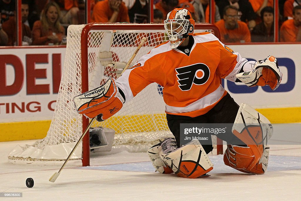 Michael Leighton #49 of the Philadelphia Flyers clears the puck against the Montreal Canadiens in Game 1 of the Eastern Conference Finals during the 2010 NHL Stanley Cup Playoffs at Wachovia Center on May 16, 2010 in Philadelphia, Pennsylvania.