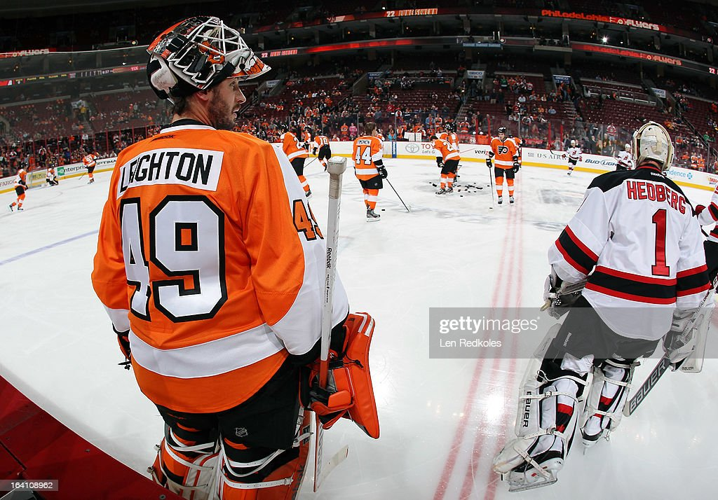 Michael Leighton #49 of the Philadelphia Flyers looks on during warm-ups prior to his game against Johan Hedberg #1 of the New Jersey Devils on March 15, 2013 at the Wells Fargo Center in Philadelphia, Pennsylvania.