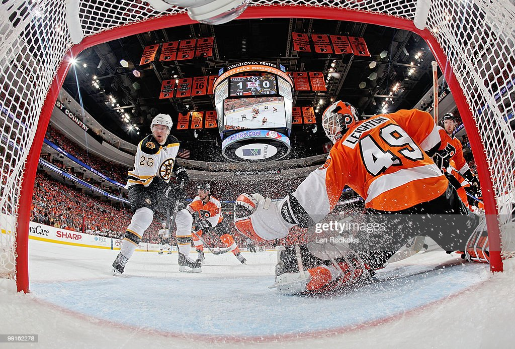 Michael Leighton #49 of the Philadelphia Flyers makes a glove save as Blake Wheeler #26 of the Boston Bruins anticipates a rebound in Game Six of the Eastern Conference Semifinals during the 2010 NHL Stanley Cup Playoffs at the Wachovia Center on May 12, 2010 in Philadelphia, Pennsylvania. The Flyers would go on to defeat the Bruins 2-1.