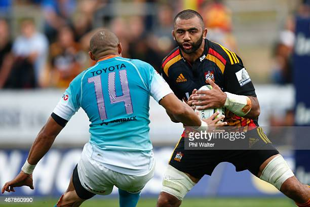 Michael Leitch of the Chiefs finds a gap past Cornal Hendricks of the Cheetahs during the round seven Super Rugby match between the Chiefs and the...