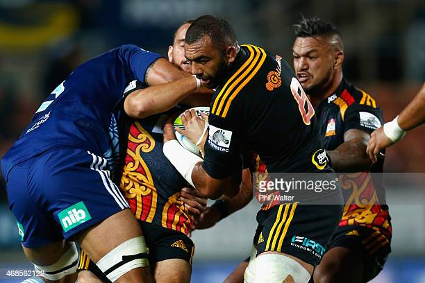 Michael Leitch of the Chiefs is tackled during the round eight Super Rugby match between the Chiefs and the Bulls at Waikato Stadium on April 4 2015...