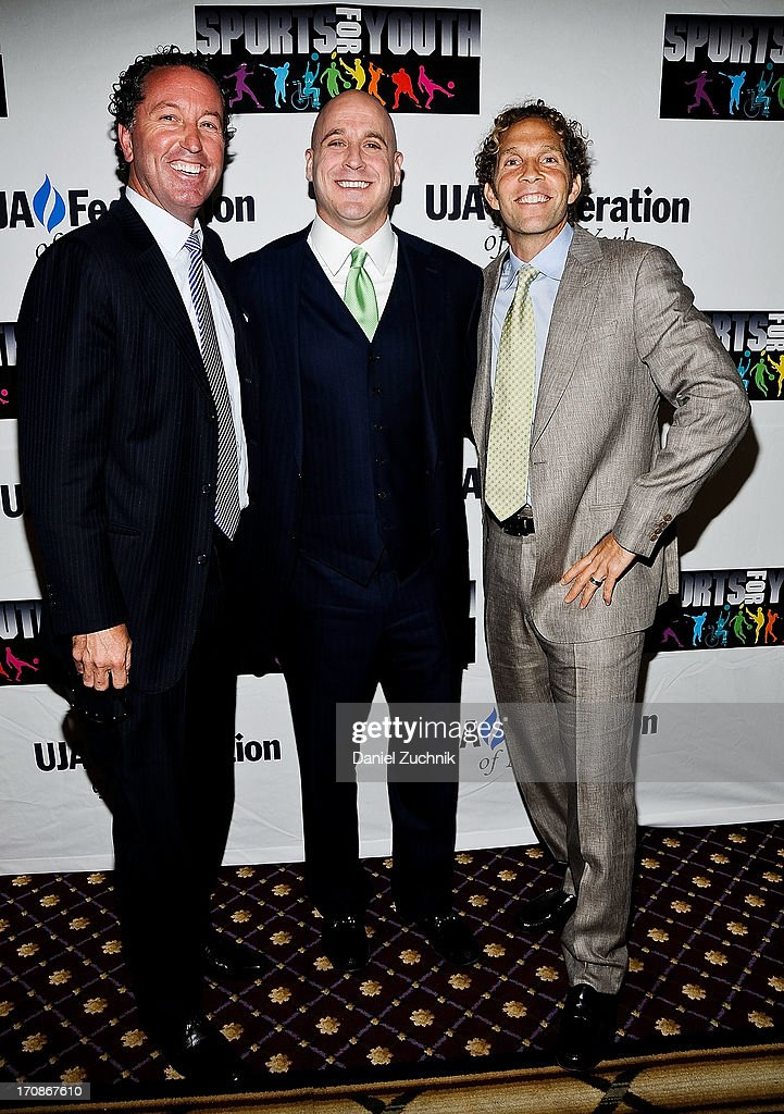 Michael Levine(C) and Jesse Itzler(R) with guest attend UJA-Federation Of New York's Sports for Youth Luncheon at The Roosevelt Hotel on June 19, 2013 in New York City.
