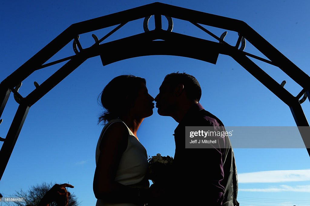 Michael Lewis and Rebecca Anderson kiss outside the Gretna Green Famous Blacksmiths Shop on the day of their wedding on Valentine's day on February 14, 2013 in Gretna,Scotland. Gretna Green is one of the most popular wedding destinations in Scotland hosting thousands of weddings each year with a particular rise on St Valentine's Day. Gretna Green has been hosting marriages in the blacksmiths shop since 1754.