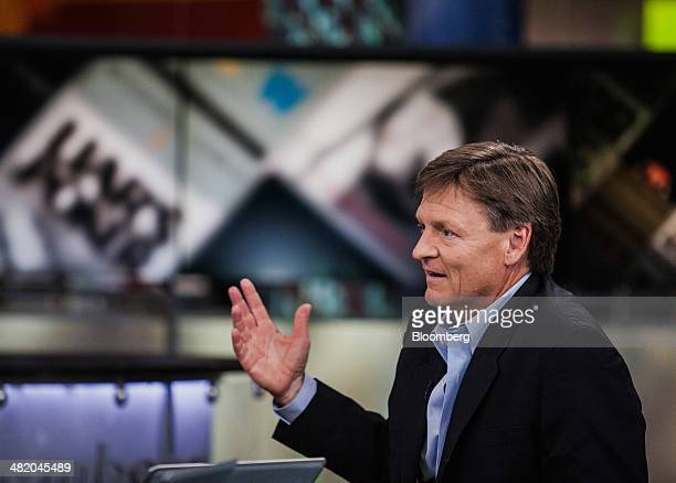 Michael Lewis author of 'Flash Boys' speaks during a Bloomberg Television interview in New York US on Wednesday April 2 2014 Lewis and Brad Katsuyama...
