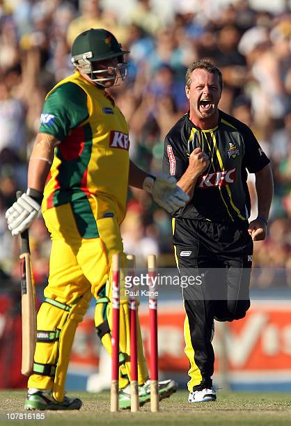 Michael Lewis of the Warriors celebrates the wicket of Mark Cosgrove of the Tigers during the Twenty20 Big Bash match between the Western Australia...