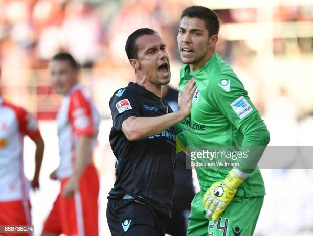 Michael Liendl and goalkeeper Stefan Ortega after a defended penalty shot during the Second Bundesliga Playoff first leg match between Jahn...