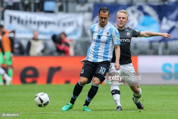 Michael Liendl of 1860 Munich and Daniel Lukasik of Sandhausen battle for the ball during the Second Bundesliga match between TSV 1860 Muenchen and...