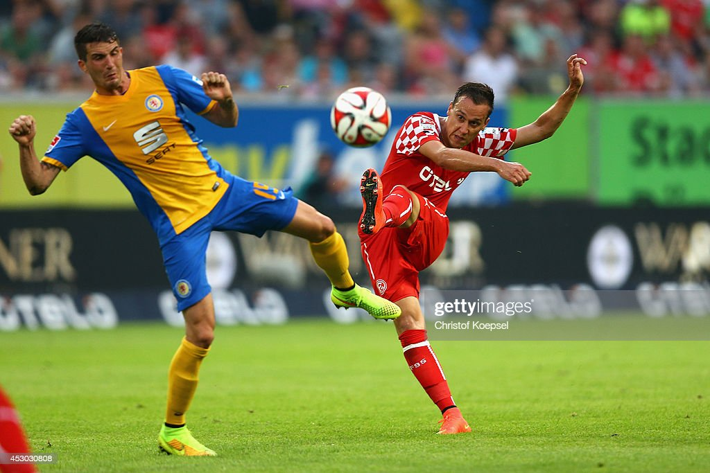 Michael Liendl of Duesseldorf scores the first goal against Ke Reichel of Braunschweig during the Second Bundesliga match between Fortuna Duesseldorf...