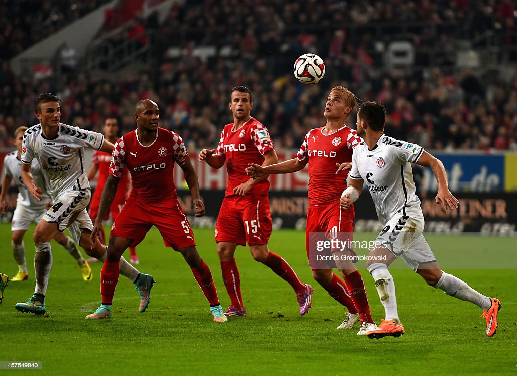 Michael Liendl of Fortuna Duesseldorf clears the ball under the pressure of Enis Alushi of FC St Pauli during the Second Bundesliga match between...