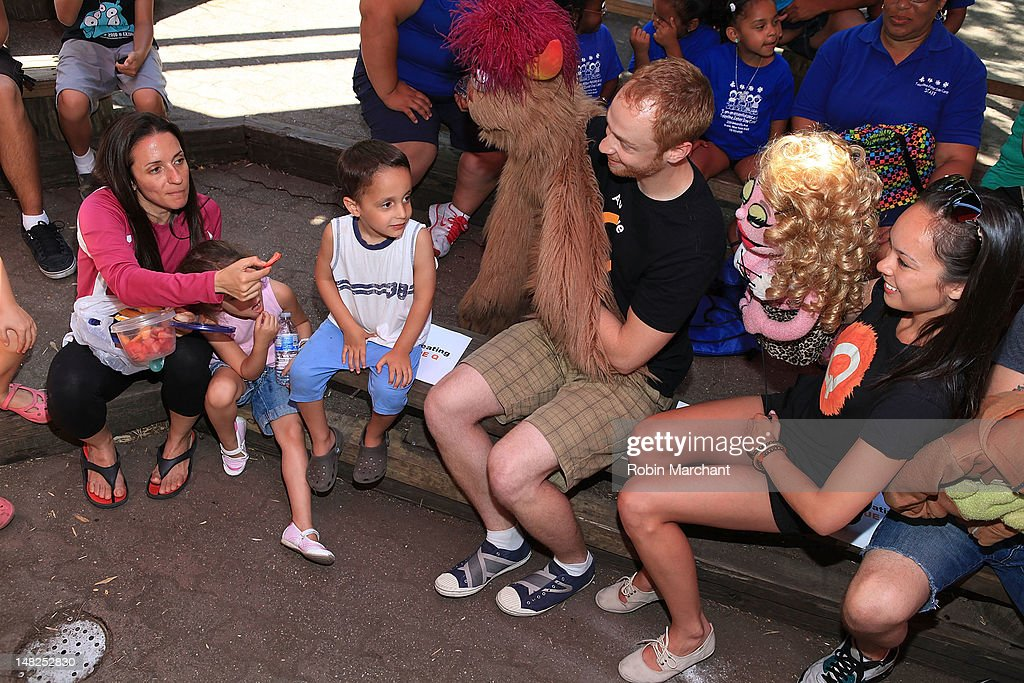 Michael Liscio Jr. and Kate Lippstreu of Avenue Q visit at Bronx Zoo on July 12, 2012 in New York City.