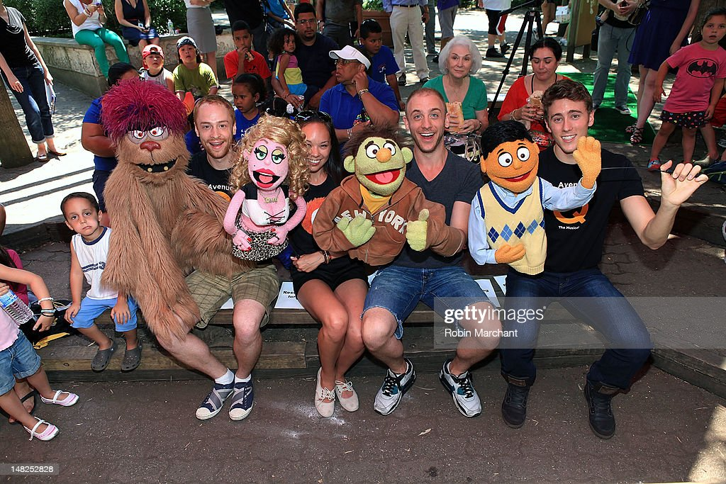 Michael Liscio Jr., Kate Lippstreu, Rob Morrison and Darren Bluestone of Avenue Q visit at Bronx Zoo on July 12, 2012 in New York City.