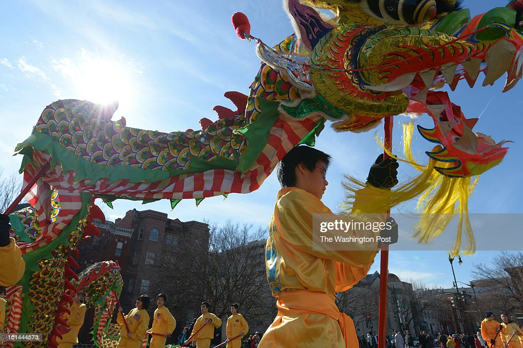 Michael Liu and other members of the New World Bilingual Institute Dragon Dance Team warm up before a parade to celebrate the Chinese New Year on Sunday February 10, 2013 in Washington, DC. Scores of people turned out for the event that ushers in the year of the Snake.