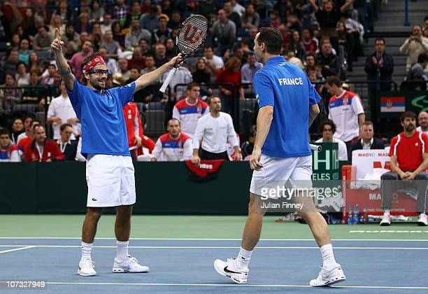 Michael Llodra and Arnaud Clement of France celebrate at match point as they beat Nenad Zimonjic and Viktor Troicki of Serbia in the doubles during...
