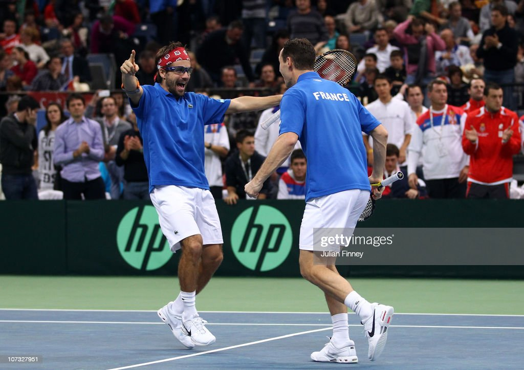 <a gi-track='captionPersonalityLinkClicked' href=/galleries/search?phrase=Michael+Llodra&family=editorial&specificpeople=208919 ng-click='$event.stopPropagation()'>Michael Llodra</a> (R) and <a gi-track='captionPersonalityLinkClicked' href=/galleries/search?phrase=Arnaud+Clement&family=editorial&specificpeople=203192 ng-click='$event.stopPropagation()'>Arnaud Clement</a> of France celebrate at match point as they beat Nenad Zimonjic and Viktor Troicki of Serbia in the doubles during day two of the Davis Cup Tennis Final at the Begrade Arena on December 4, 2010 in Belgrade, Serbia.