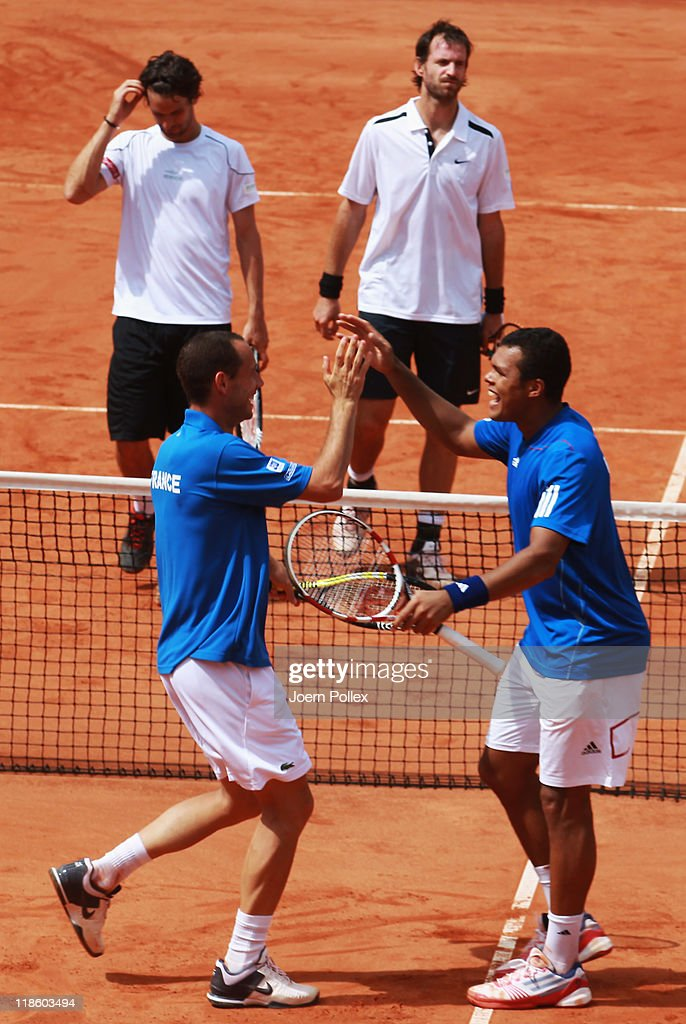 Michael Llodra (2nd L) and <a gi-track='captionPersonalityLinkClicked' href=/galleries/search?phrase=Jo-Wilfried+Tsonga&family=editorial&specificpeople=553803 ng-click='$event.stopPropagation()'>Jo-Wilfried Tsonga</a> (2nd R) of France celebrates after winning their doubles match against <a gi-track='captionPersonalityLinkClicked' href=/galleries/search?phrase=Christopher+Kas&family=editorial&specificpeople=987913 ng-click='$event.stopPropagation()'>Christopher Kas</a> and <a gi-track='captionPersonalityLinkClicked' href=/galleries/search?phrase=Philipp+Petzschner&family=editorial&specificpeople=2464261 ng-click='$event.stopPropagation()'>Philipp Petzschner</a> (L) of Germany during day two of the quarter-finals match in the Davis Cup World Group at Tennis club Weissenhof on July 9, 2011 in Stuttgart, Germany.