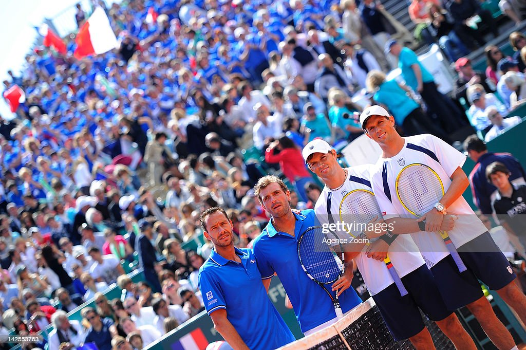 <a gi-track='captionPersonalityLinkClicked' href=/galleries/search?phrase=Michael+Llodra&family=editorial&specificpeople=208919 ng-click='$event.stopPropagation()'>Michael Llodra</a> and <a gi-track='captionPersonalityLinkClicked' href=/galleries/search?phrase=Julien+Benneteau&family=editorial&specificpeople=228097 ng-click='$event.stopPropagation()'>Julien Benneteau</a> of France and <a gi-track='captionPersonalityLinkClicked' href=/galleries/search?phrase=Bob+Bryan+-+Tennis+Player&family=editorial&specificpeople=203335 ng-click='$event.stopPropagation()'>Bob Bryan</a> and <a gi-track='captionPersonalityLinkClicked' href=/galleries/search?phrase=Mike+Bryan+-+Tennis+Player&family=editorial&specificpeople=204456 ng-click='$event.stopPropagation()'>Mike Bryan</a> of USA pose after the Bryan brothers won their quarterfinal match during Day 2 of the Davis Cup Monte-Carlo Rolex Masters Quarter Final on April 07 2012, in Monte-Carlo, France.