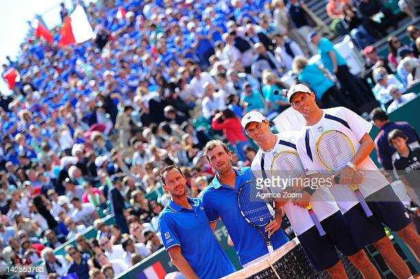Michael Llodra and Julien Benneteau of France and Bob Bryan and Mike Bryan of USA pose after the Bryan brothers won their quarterfinal match during...