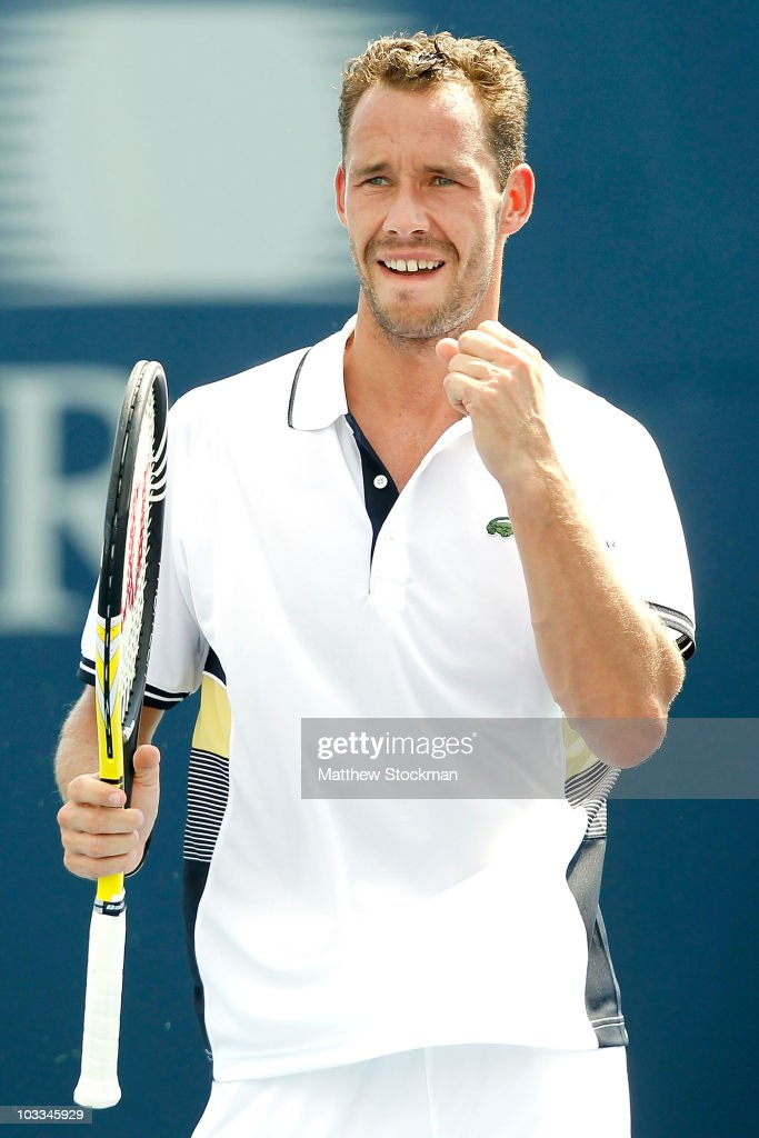 <a gi-track='captionPersonalityLinkClicked' href=/galleries/search?phrase=Michael+Llodra&family=editorial&specificpeople=208919 ng-click='$event.stopPropagation()'>Michael Llodra</a> of Frace celebrates match point against Nicolas Almagro of Spain during the Rogers Cup at the Rexall Centre on August 11, 2010 in Toronto, Canada.