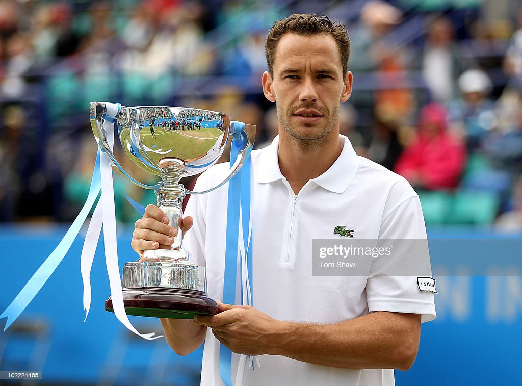 <a gi-track='captionPersonalityLinkClicked' href=/galleries/search?phrase=Michael+Llodra&family=editorial&specificpeople=208919 ng-click='$event.stopPropagation()'>Michael Llodra</a> of France celebrates with the trophy after winning the Final against Guillermo Garcia-Lopez of Spain during day six of the AEGON International at Devonshire Gardens on June 19, 2010 in Eastbourne, England.