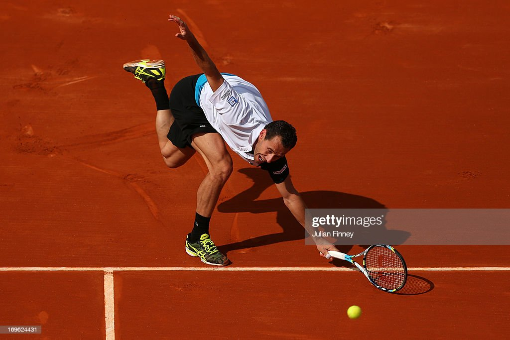 <a gi-track='captionPersonalityLinkClicked' href=/galleries/search?phrase=Michael+Llodra&family=editorial&specificpeople=208919 ng-click='$event.stopPropagation()'>Michael Llodra</a> of France reaches to plays a forehand in his Men's Singles match against Milos Raonic of Cananda during day four of the French Open at Roland Garros on May 29, 2013 in Paris, France.