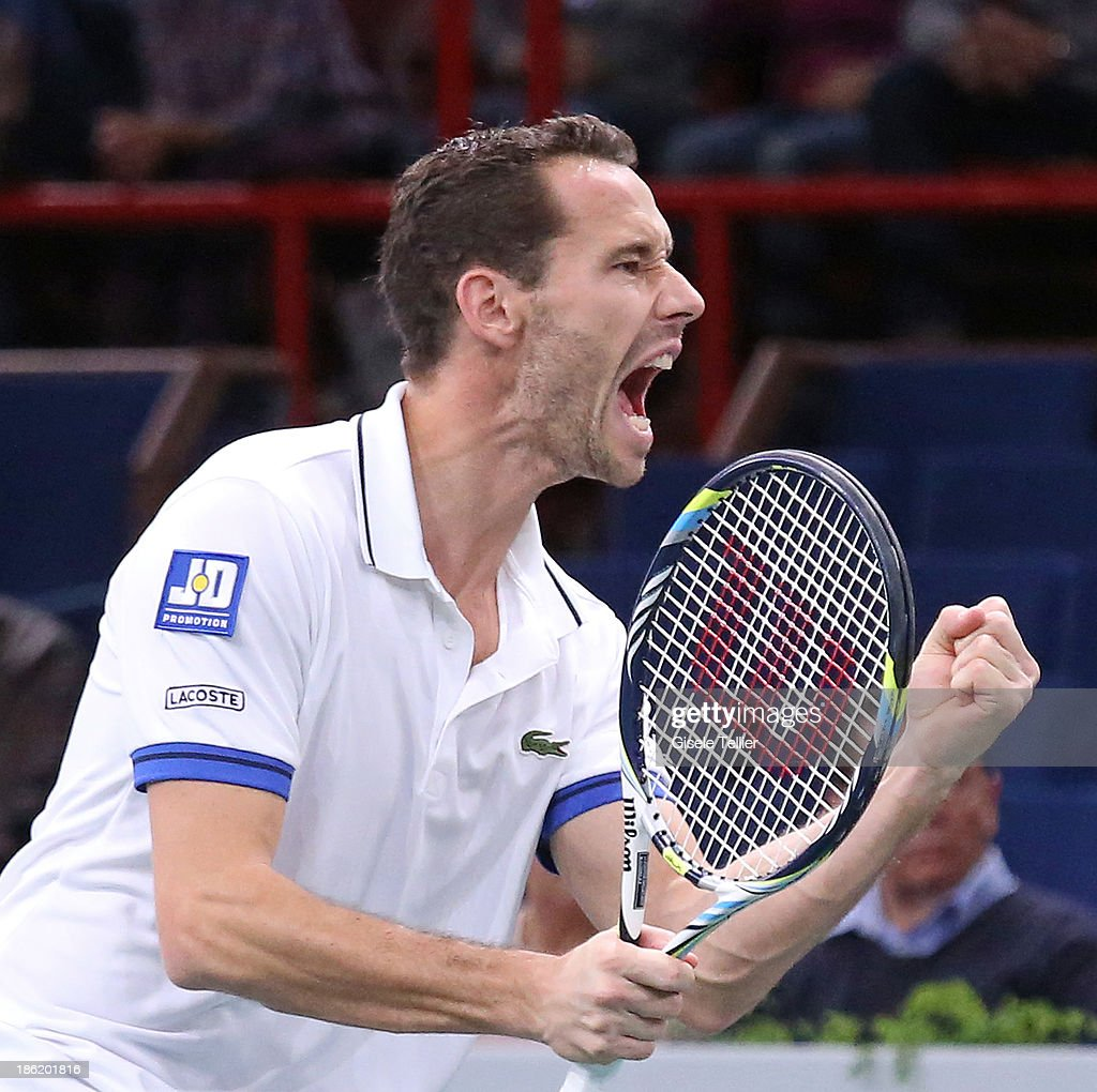 Michael LLodra of France reacts after a point during his first round match against Grigor Dimitrov of Bulgaria during the BNP Paribas Masters at Palais Omnisports de Bercy on October 29, 2013 in Paris, France.