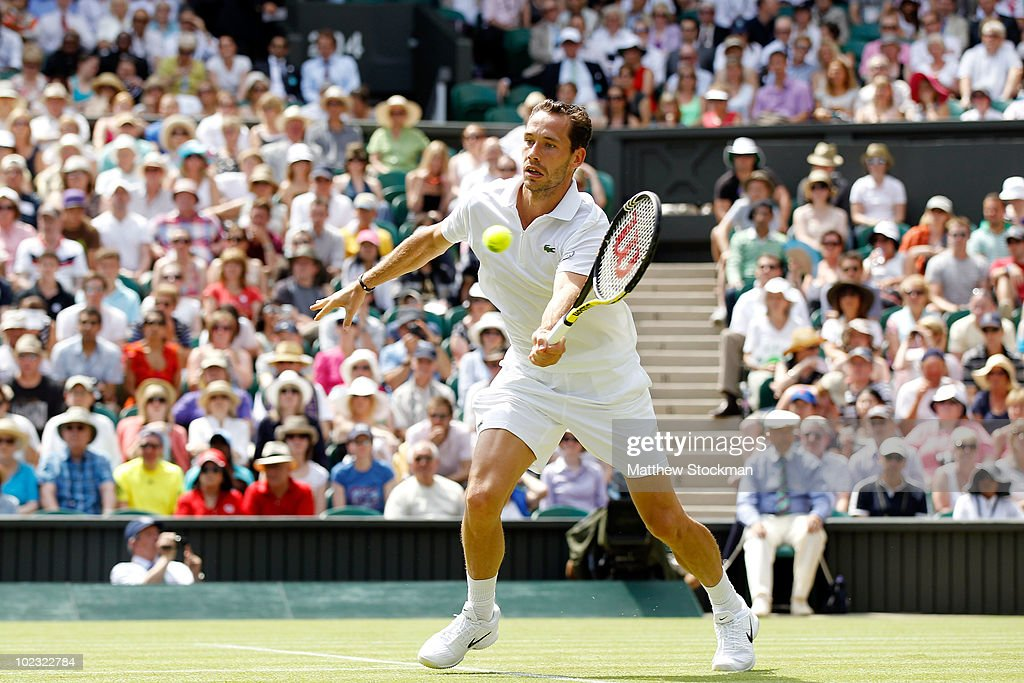 <a gi-track='captionPersonalityLinkClicked' href=/galleries/search?phrase=Michael+Llodra&family=editorial&specificpeople=208919 ng-click='$event.stopPropagation()'>Michael Llodra</a> of France reacts during his second round match against Andy Roddick of USA on Day Three of the Wimbledon Lawn Tennis Championships at the All England Lawn Tennis and Croquet Club on June 23, 2010 in London, England.