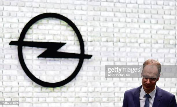 Michael Lohscheller CEO of Opel stands in front of his company's logo during the official opening of the Internationale Automobil Ausstellung auto...
