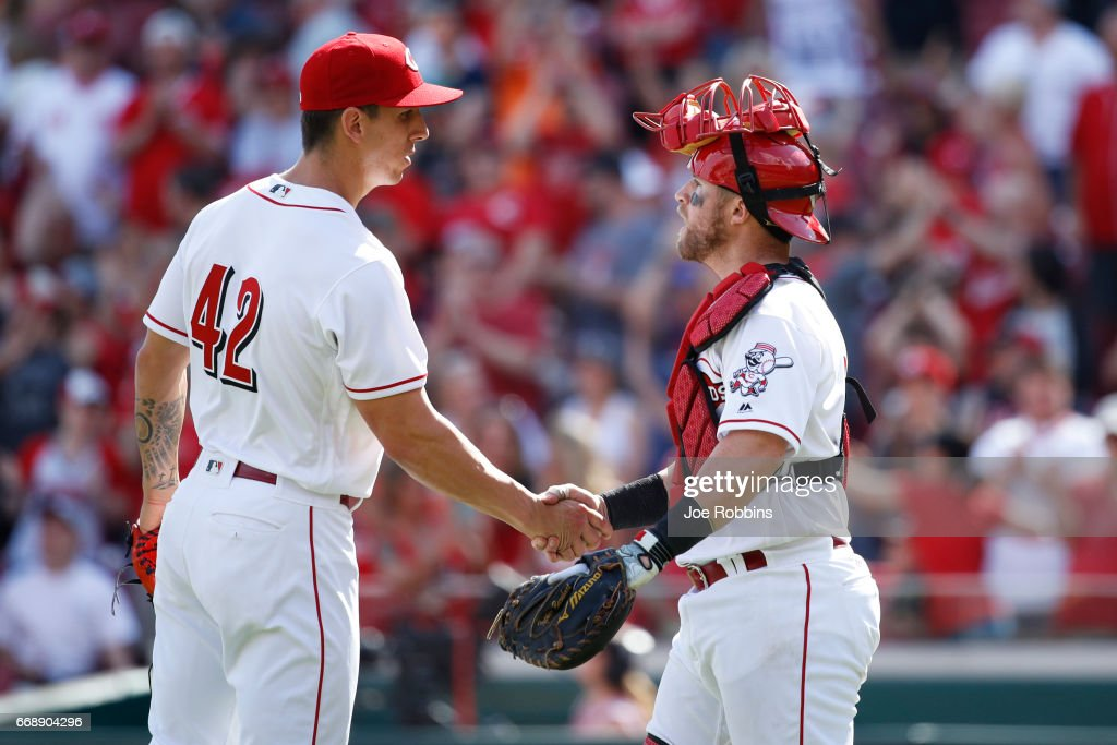 Michael Lorenzen #21 and Tucker Barnhart #16 of the Cincinnati Reds celebrate after the final out in the ninth inning of the game against the Milwaukee Brewers at Great American Ball Park on April 15, 2017 in Cincinnati, Ohio. The Reds defeated the Brewers 7-5. All players are wearing #42 in honor of Jackie Robinson Day.