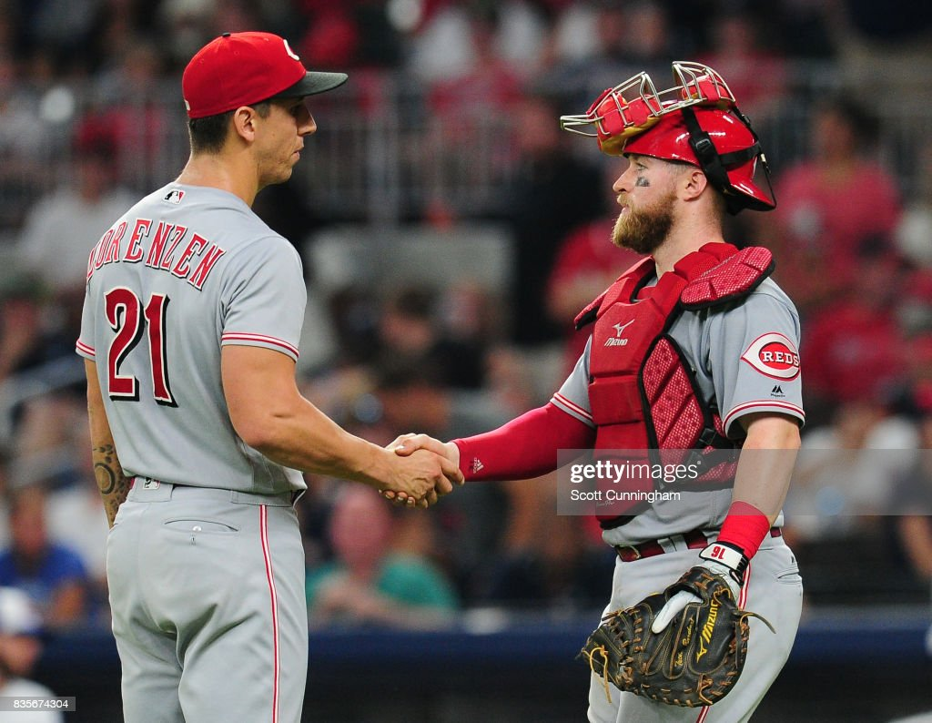 Michael Lorenzen #21 and Tucker Barnhart #16 of the Cincinnati Reds celebrate after the game against the Atlanta Braves at SunTrust Park on August 19, 2017 in Atlanta, Georgia.