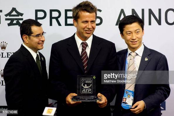 Michael Luevano CEO of ATP International Brad Drewett center and Leon Sun pose for the media at a press conference to announce Rolex as the...