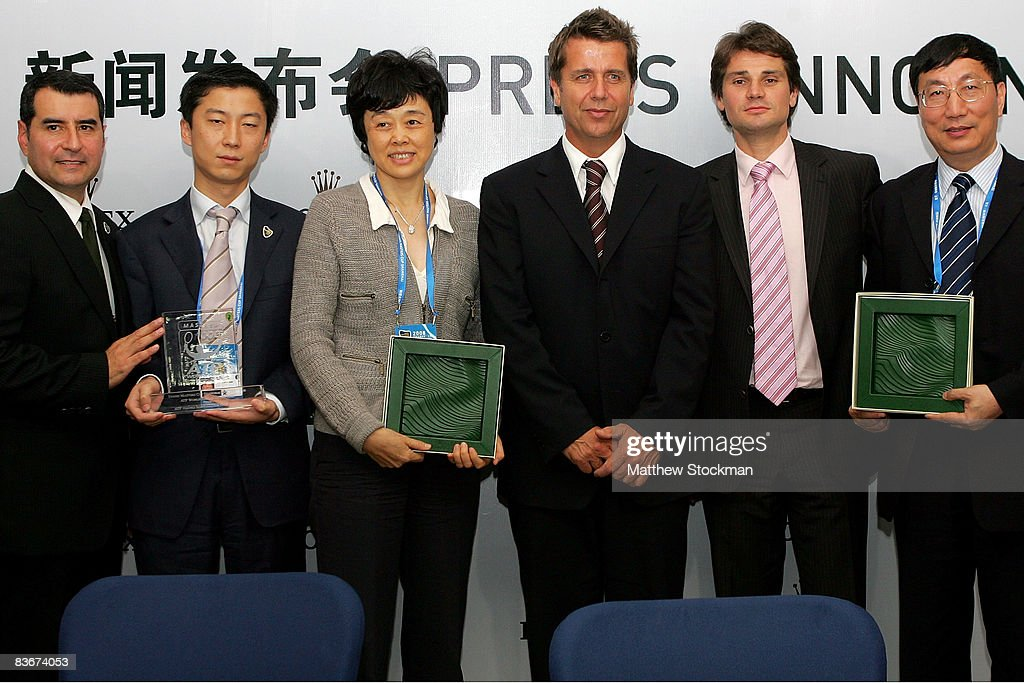 Michael Luevano Leon Sun Sun Jinfang CEO of ATP International Brad Drewett Arnaud Boetsch and Qiu Weichang pose for photographers after a press...