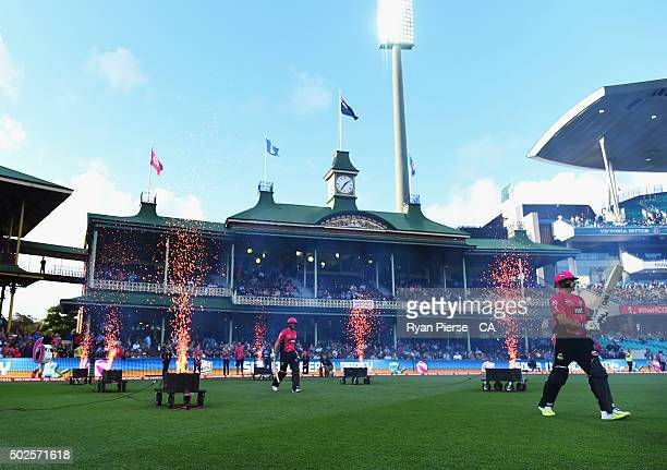 Michael Lumb and Brad Haddin of the Sixers walk out to bat during the Big Bash League match between the Sydney Sixers and the Melbourne Stars at...