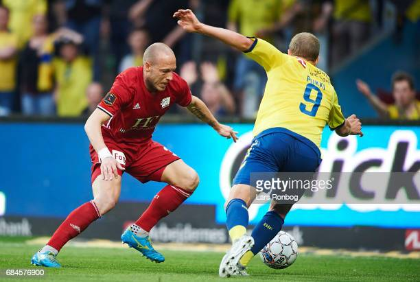 Michael Lumb of Lyngby BK and Teemu Pukki of Brondby IF compete for the ball during the Danish Alka Superliga match between Brondby IF and Lyngby BK...