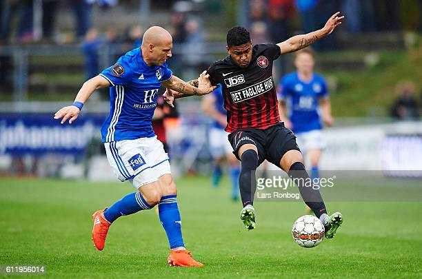 Michael Lumb of Lyngby Boldklub and Bruninho of FC Midtjylland compete for the ball during the Danish Alka Superliga match between Lyngby BK and FC...