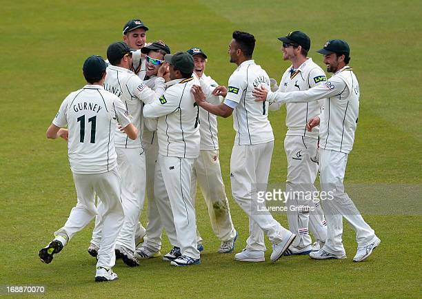 Michael Lumb of Nottinghamshire is congratulated on his catch to dismiss Arun Harinath of Surrey during day two of the LV County Championship...