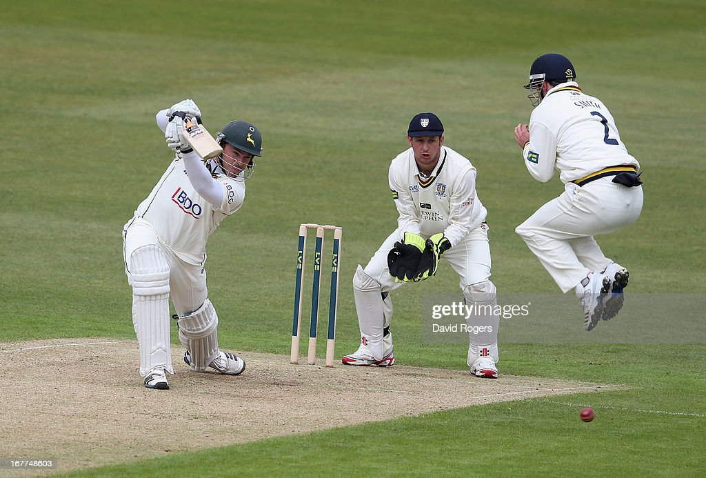 Michael Lumb of Nottinghamshire plays the ball past Will Smith for four runs during day one of the LV County Championship division one match between Nottinghamshire and Durham at Trent Bridge on April 29, 2013 in Nottingham, England.