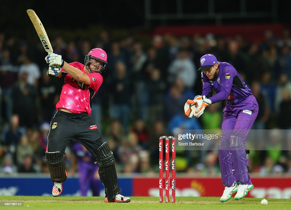 <a gi-track='captionPersonalityLinkClicked' href=/galleries/search?phrase=Michael+Lumb+-+Cricketer&family=editorial&specificpeople=6946049 ng-click='$event.stopPropagation()'>Michael Lumb</a> of the Sixers bats as wicketkeeper <a gi-track='captionPersonalityLinkClicked' href=/galleries/search?phrase=Tim+Paine&family=editorial&specificpeople=3990549 ng-click='$event.stopPropagation()'>Tim Paine</a> of the Hurricanes looks on during the Big Bash League match between the Hobart Hurricanes and the Sydney Sixers at Blundstone Arena on December 23, 2014 in Hobart, Australia.