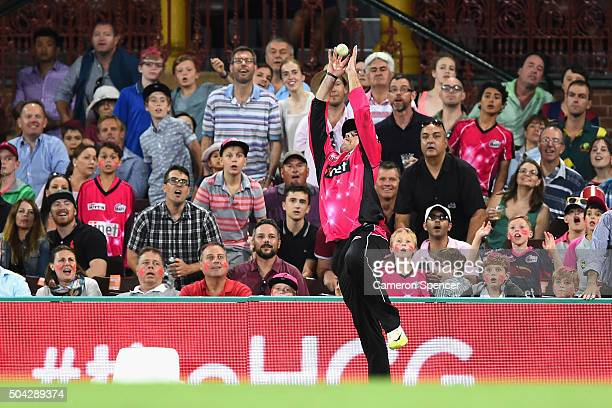 Michael Lumb of the Sixers catches Joe Burns of the Heat off a delivery by team mate Sean Abbott of the Sixers during the Big Bash League match...