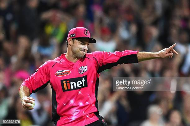 Michael Lumb of the Sixers celebrates catching Glen Maxwell of the Stars off a delivery by team mate Doug Bollinger during the Big Bash League match...