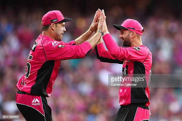 Michael Lumb of the Sixers celebrates with Nathan Lyon of the Sixers after catching Heat captain Chris Lynn off a delivery by team mate Doug...