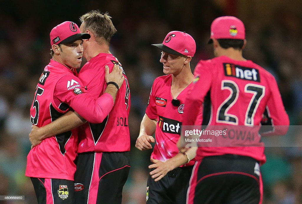 <a gi-track='captionPersonalityLinkClicked' href=/galleries/search?phrase=Michael+Lumb+-+Cricketer&family=editorial&specificpeople=6946049 ng-click='$event.stopPropagation()'>Michael Lumb</a> of the Sixers celebrates with team mates after taking a catch to dismiss <a gi-track='captionPersonalityLinkClicked' href=/galleries/search?phrase=Tom+Cooper+-+Cricketer&family=editorial&specificpeople=13732135 ng-click='$event.stopPropagation()'>Tom Cooper</a> of the Renegades during the Big Bash League match between the Sydney Sixers and Melbourne Renegades at Sydney Cricket Ground on December 19, 2014 in Sydney, Australia.